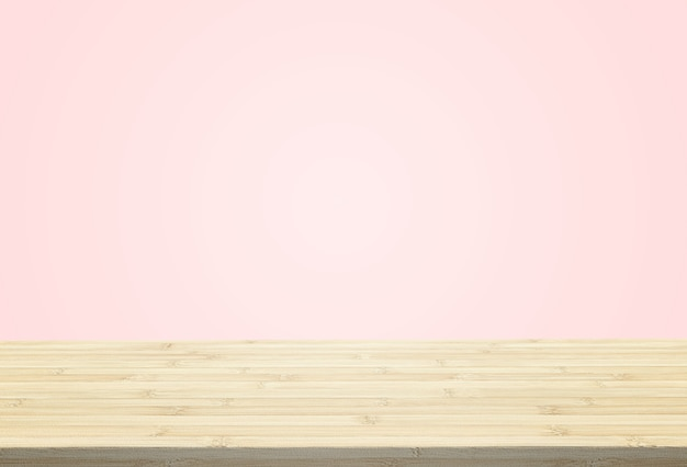 Laminate table top on pastel pink background can put or montage your products