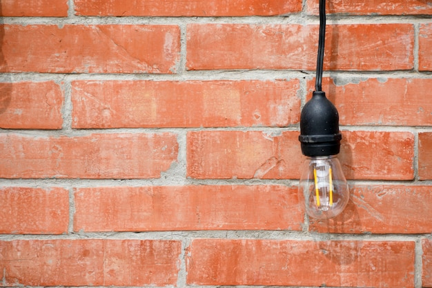 Lamp on brick wall interior design