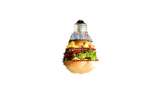 白い背景で隔離の電球。新しいアイデアのコンセプト。ガラスの中のハンバーガー。食品広告。