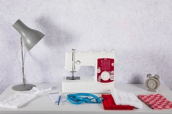 Lamp near sewing machine on table