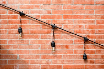 Lamp on brick wall