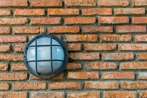 Lamp on red brick wall