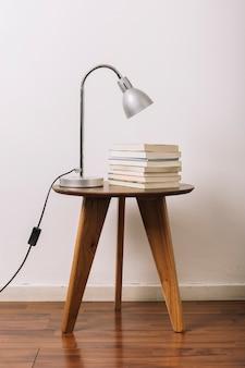 Lamp on table near books