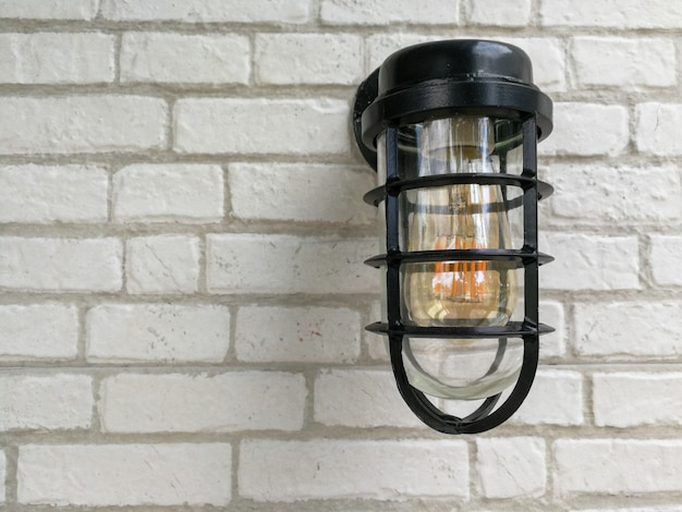 Lamp and white bricks wall background