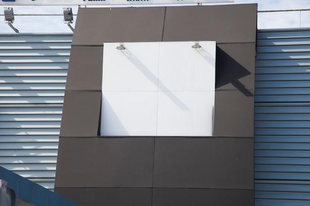Lamp on white empty billboard on wall