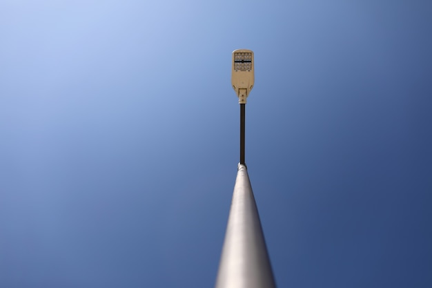 Lamppost on blue sky background