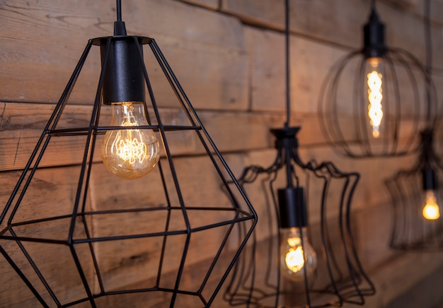 Lamps with warm light, for decoration, against the background of old wood