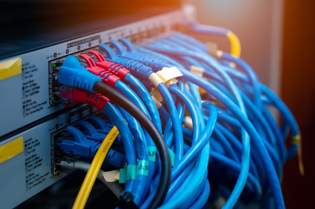 Lan cable plug into switch, networking system connection, data tranfer and internet wiring, computer graphic flare light