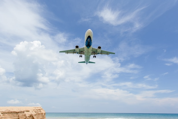 Landing aircraft above the beach at phuket airport. mai khao beach