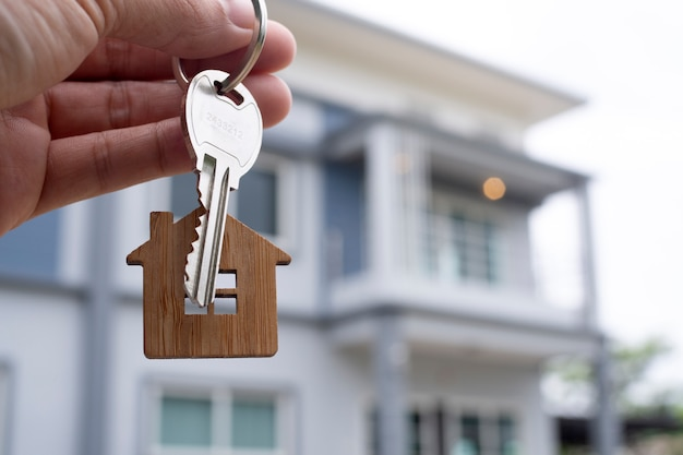 Landlord unlocks the house key for new home.  real estate agents, sales agents  .