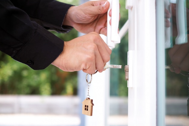 Landlord unlocks the house key for new home