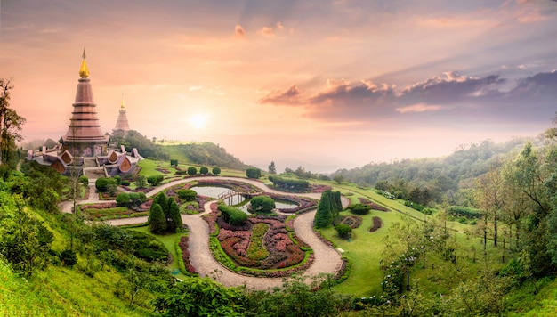 Landmark pagoda in doi inthanon with mist fog during sunset timeat chiang mai, thailand