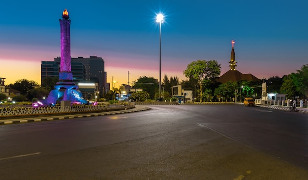 Landmark of tugumuda on a beautiful morning against the background of the cathedral church semarang