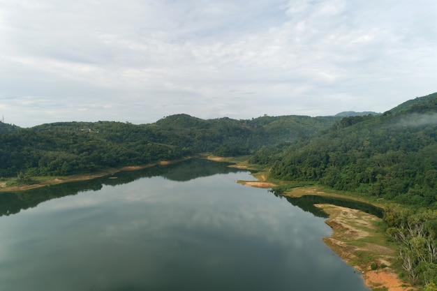 Landscape aerial view drone shot of mountain around the dam tropical rainforest in thailand