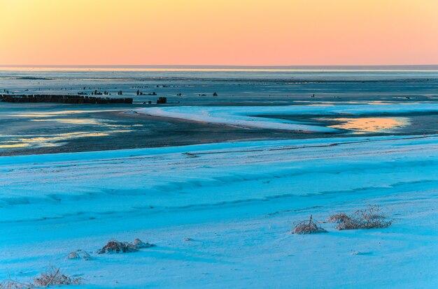 Landscape beautiful golden sunset red sky over salt lake elton.