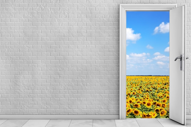 벽돌 벽 앞 열린 문 뒤의 풍경. 3d 렌더링
