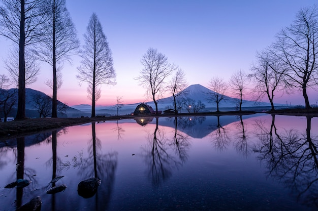 Landscape blue sky fumoto para camping ground and fuji mountain with tree reflection