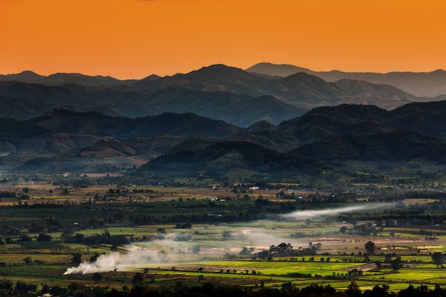 Landscape in chiang mai northern of thailand with farmland and mountains background