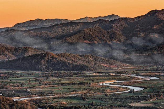 Landscape in chiang mai northern of thailand with kok river and moutain background