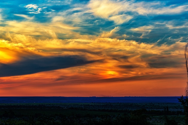 The landscape of a colorful sunset over the plain