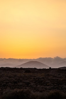 Landscape of a crater of a volcano at sunset in fuerteventura, canary islands, spain