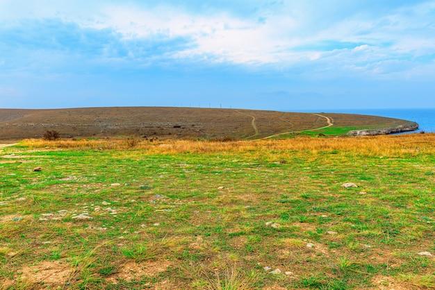 Landscape of the deserted black sea coast with sparse vegetation in the crimea