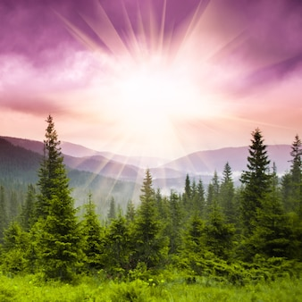 風景-夕日の山を越えて