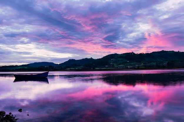 Landscape from asturias, spain.reflection of single boat
