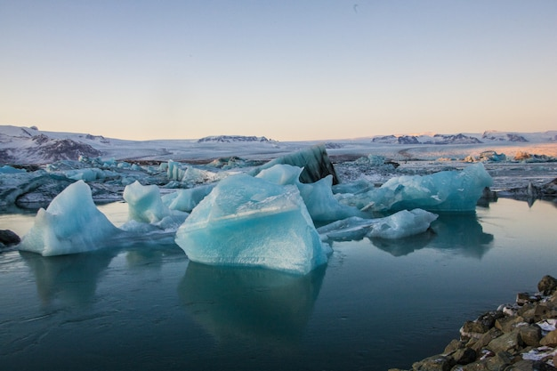 Landscape of icebergs with rocks in jökulsarlon glacier lagoon in iceland
