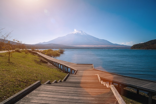 Landscape image of fuji mountain with wooden walkway in the autumn on yamanaka lake at yamanashi, japan.