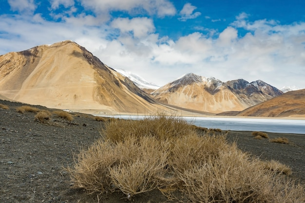 Landscape image of pangong lake and mountains view background in ladakh, india.