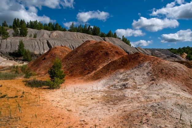 Landscape like a planet mars surface amazing sky beautiful clouds ural refractory clay quarries