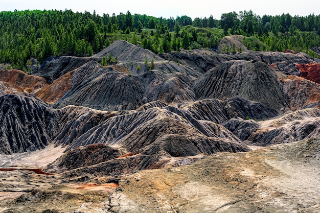 Landscape like a planet mars surface. solidified red-brown black earth surface. cracked and scorched land. refractory clay quarries.