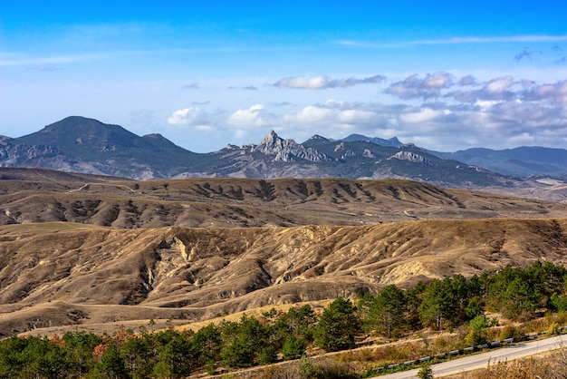 Landscape of loamy relief foothills and rocky mountains of the crimea