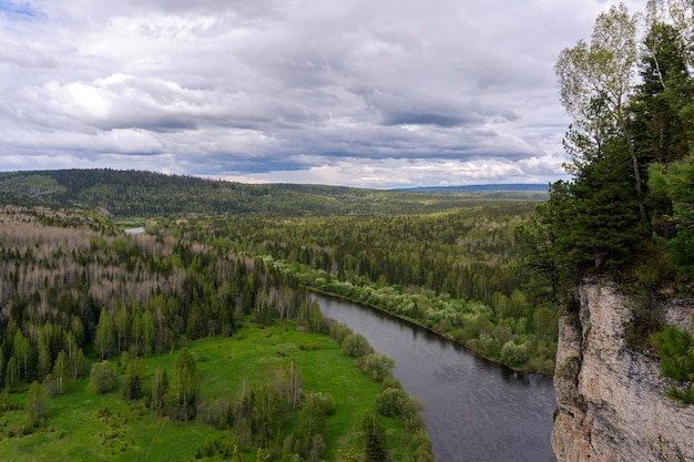 Landscape of the middle urals a view from a high cliff on a spring wooded hilly river valley