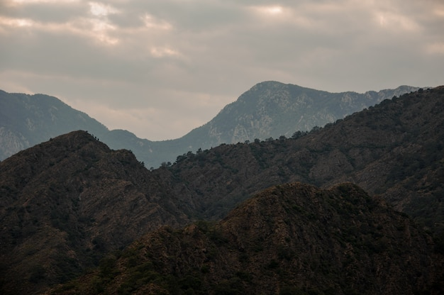 Landscape of the mountain under the cloudy sky with light