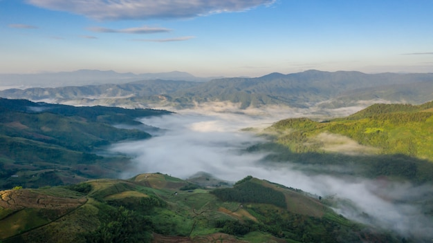 Landscape mountain fog at morning time the sunrise and cloud sky background chiang rai view point thailand