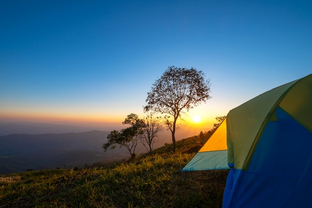 Landscape mountain at sunset with tent camping.