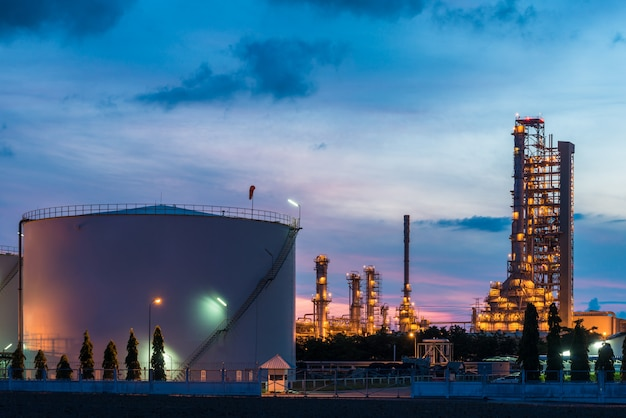 Landscape of oil refinery industry with oil storage tank in night.