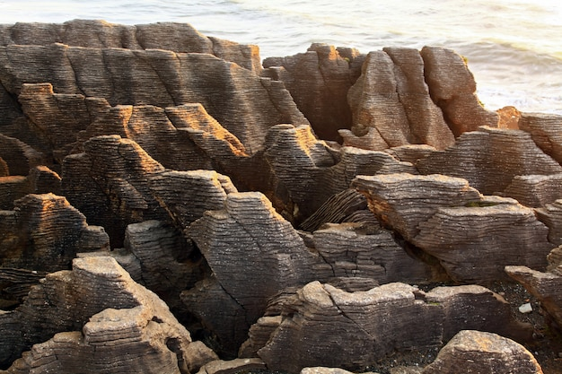 Landscape of pancake grand canyon rock at west coast beach new z