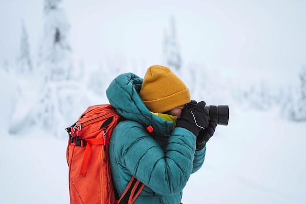 Landscape photographer capturing a snowy lapland