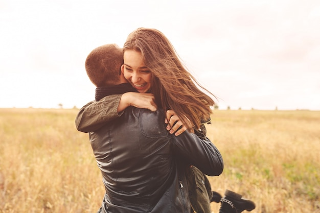 Landscape portrait of young beautiful stylish couple sensual and having fun outdoor