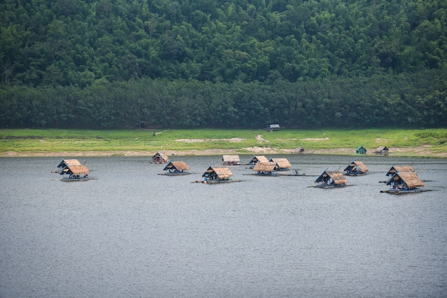 Landscape of river mountain and bamboo houseboat raft floating on riverside