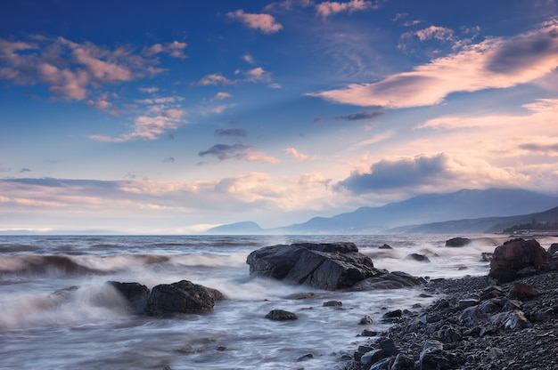Landscape of sea with waves and sky with clouds
