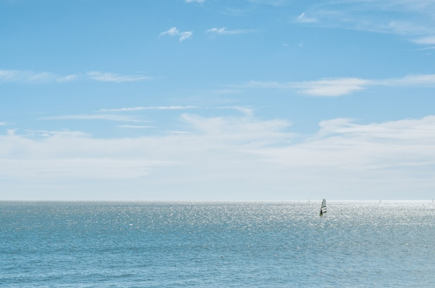 Landscape of the sea with windsurfer