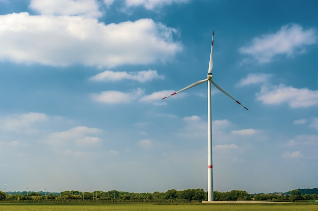 Landscape shot of a sole windmill of a clear blue sky