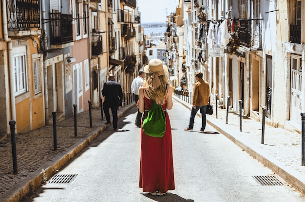 A landscape shot of a young female traveler