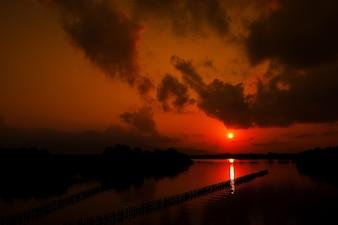 Landscape silhouette at sunrise.