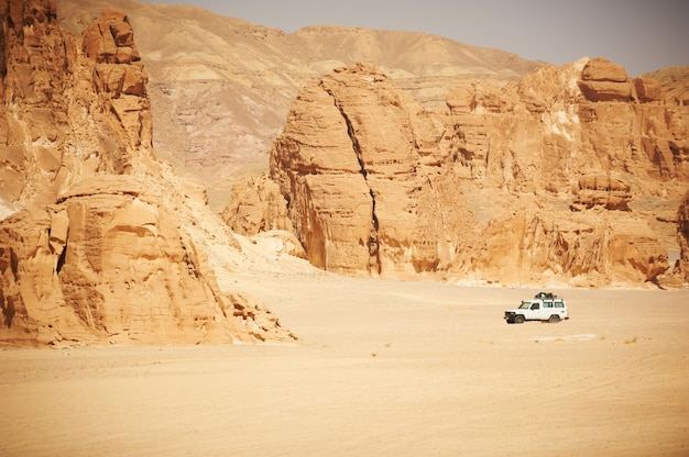 Landscape of sinai desert with rocks and jeep for safari.