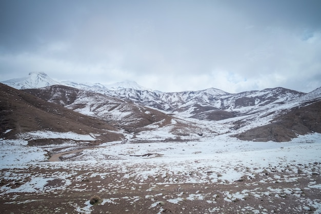 Landscape of snow capped mountains in the high atlas range, morocco.
